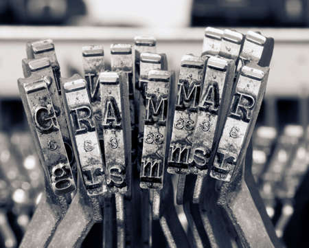 the word GRAMMER  with old typwriter keys  monochrome