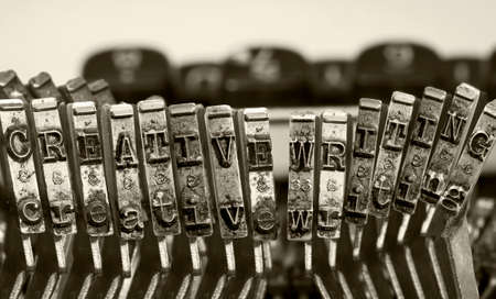 the words CREATIVE WRITING with old typwriter keys  monochrome Фото со стока