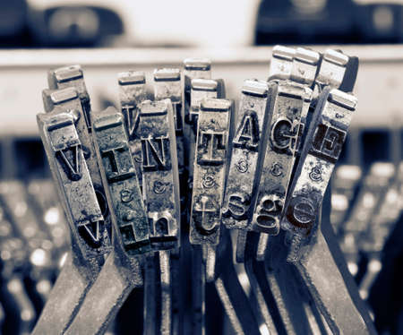the word   vintage  with old typwriter keys  monochrome Фото со стока