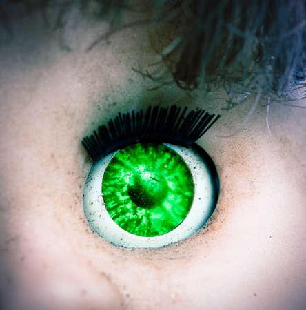 macro image of a old spooky doll,s eye Standard-Bild