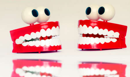 two fun plastic teeth  with eyes   chatting