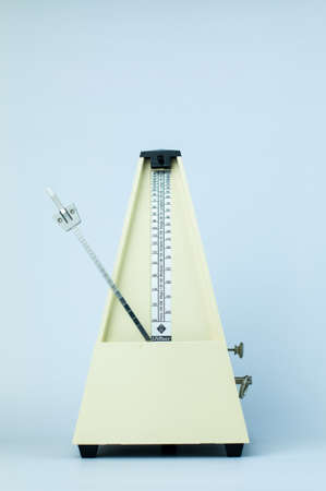 Classic Yellow Metronome in White Isolated Background