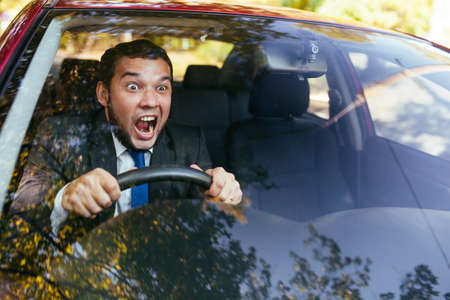 Shocked driver in the car, frightened man driving. Stock fotó