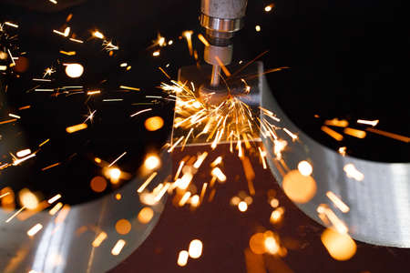 Drill with diamond-tipped polishing metal parts. Sparks.