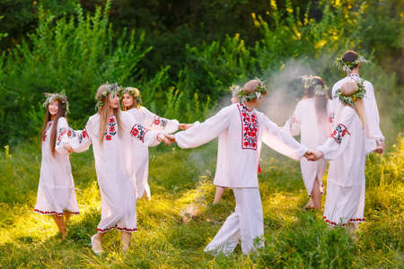 Midsummer. A group of young people of Slavic appearance at the celebration of Midsummer Фото со стока