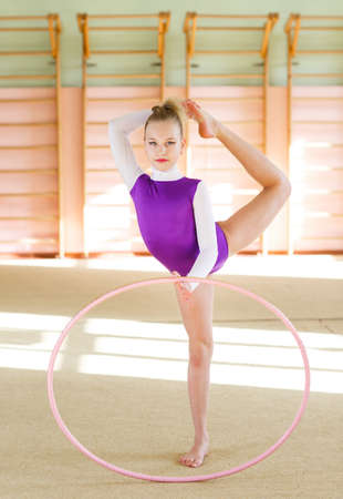 Young girl doing gymnastics in the gym.