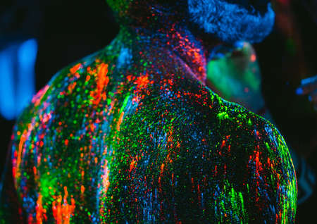 Ultraviolet powder texture. The man is painted in ultraviolet powder.