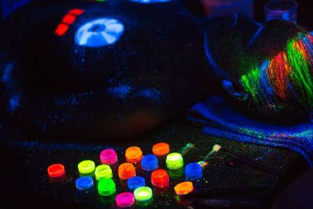 Multicolored UV powder in containers