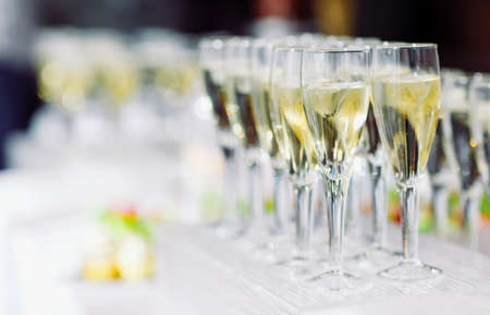 glasses of champagne with ice cube on the holiday table Stock Photo