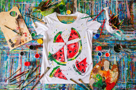 Drawing on clothes. drawing watermelon on a white t-shirt.