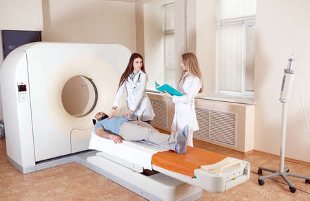 Happy patient undergoing mri scan at hospital 写真素材