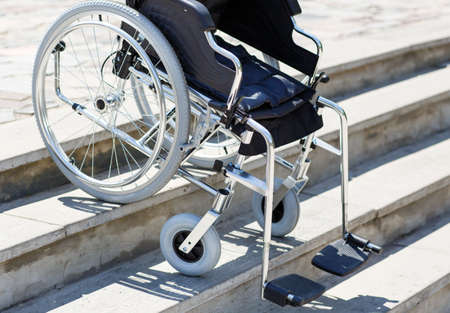 Wheelchair near the steps outdoors in the park.