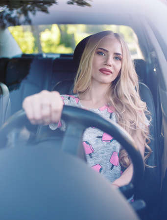 A young pretty girl is driving a car. 写真素材 - 131694084