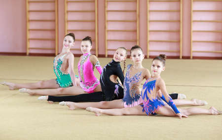 Young girls doing gymnastics in the gym.