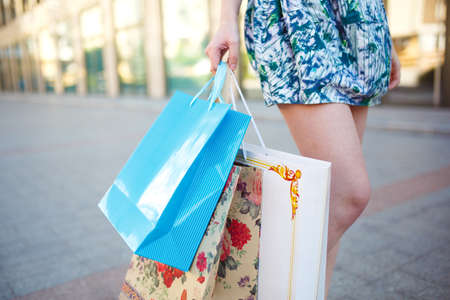 Girl with shopping bags near the mall. Imagens