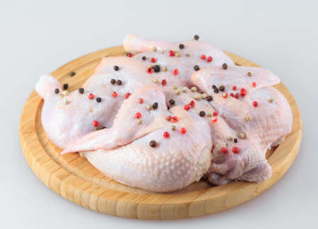 raw chicken carcass on the cutting board isolated on white background Stock Photo - 127816427
