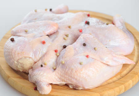 raw chicken carcass on the cutting board isolated on white background Stock Photo