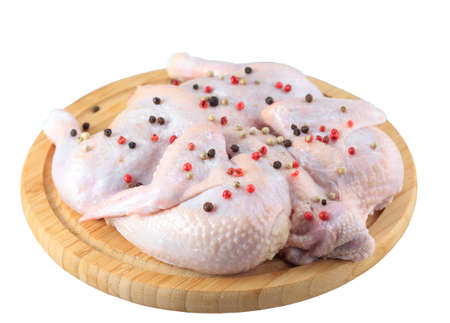 raw chicken carcass on the cutting board isolated on white background. Stock Photo