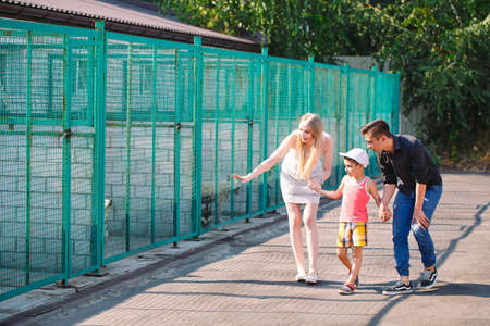 A young family is looking for a pet in a dog shelter. Stock Photo