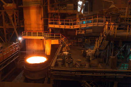 Melting of metal in a steel plant. High temperature in the melting furnace. Metallurgical industry. 写真素材