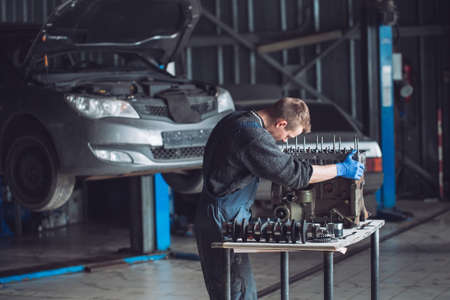Master collects a rebuilt motor for the car 写真素材