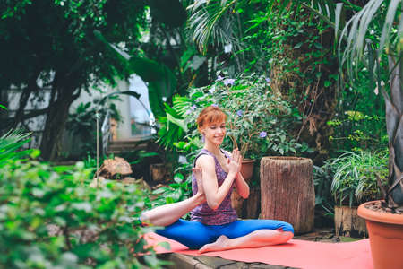 Portrait of gorgeous young woman practicing yoga indoor. Calmness and relax, female happiness. 写真素材 - 131693466