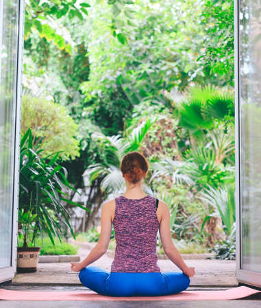 Portrait of gorgeous young woman practicing yoga indoor. Calmness and relax, female happiness. 写真素材 - 131693738