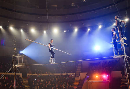 Fearless tightrope walkers at the circus arena. 写真素材