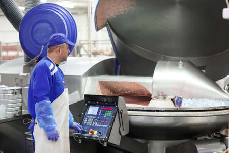 The meat in the Grinder. The meat industry Reklamní fotografie