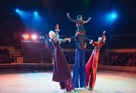 The performance of stilt-walkers in the circus