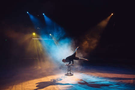 A man dancing in the circus arena Фото со стока