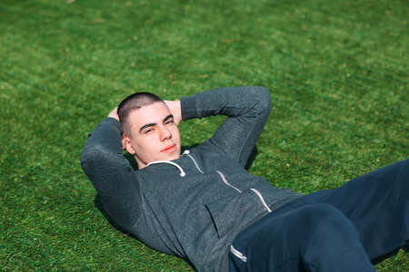 Sporty man training in on the grass