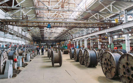 Wire rod, fittings in warehouses. industrial storehouse at the metallurgical plant Stock Photo