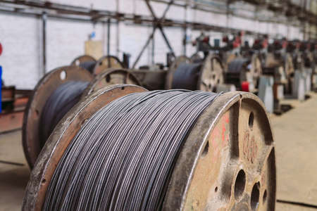 Wire rod, fittings in warehouses. industrial storehouse at the metallurgical plant Archivio Fotografico - 128252747
