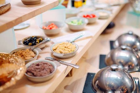 buffet in a restaurant or hotel. Metal dishes with caps