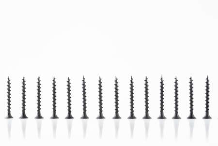 Screws still life large self tapping screws on white background.