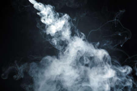 Abstract smoke isolated on a dark background. Stok Fotoğraf