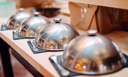 buffet in a restaurant or hotel. Metal dishes with caps.