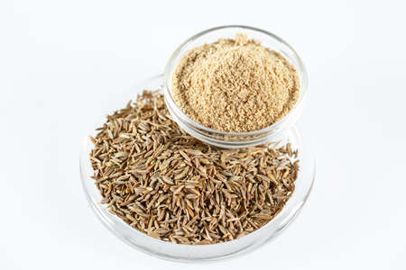 Cumin Isolated on the white background in a plate Banco de Imagens