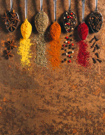 The Different Spices. Spices on stone background.