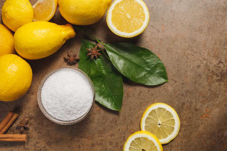 Citric acid and Lemons on the wooden backgrounde.