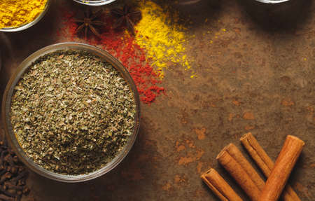 Dried Marjoram . Place for text. Different types of Spices in a bowl on a stone background. The view from the top Zdjęcie Seryjne