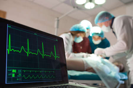 Monitoring of ECG and saturation O2 in the patient in the operating room.