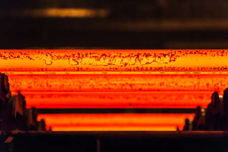 Hot billet bloom continuous casting, also called strand casting. Фото со стока