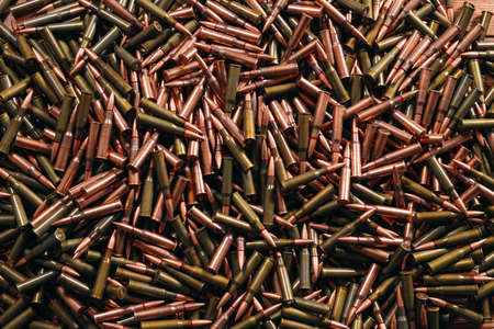 A lot of different ammo on a wooden background. 版權商用圖片