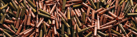A lot of different ammo on a wooden background.