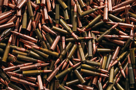 A lot of different ammo on a wooden background. Banque d'images