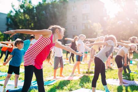 Yoga classes outside on the open air. Kids Yoga, Reklamní fotografie