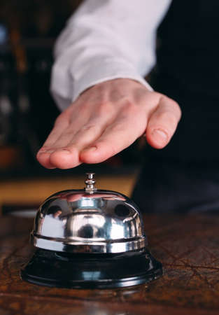 Restaurant bell vintage with hand. Hotel service bell Imagens
