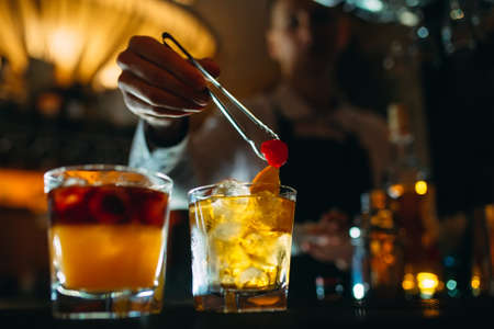 The bartender prepares cocktails at the bar.